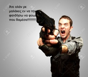 15850576-Angry-Soldier-Man-With-Gun-Isolated-On-gray-Background-Stock-Photo